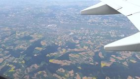 Flying over agricultural fields from an airplane stock video