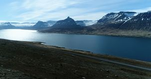 Flying out over beautiful fjord in Iceland. Flying over Alftafjordur fjord near Sudavik in the West Fjords on a beautiful day in Iceland stock footage