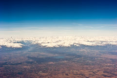 Flying over the Alps. Aerial view of the Province of Vercelli, Piedmont, Italy with snow capped Alps in the background Stock Photo