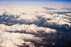 Flying over the Alps. Aerial view of snow capped Alps mountains in Italy Royalty Free Stock Image