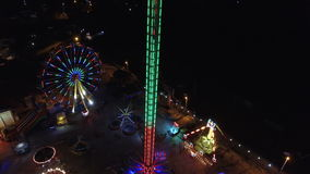 Flying over amusement park. Flying over the amusement park at night