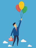 Flying over with balloon. Businessman flying into sky with colorful balloon, business concept in freedom and opportunity Royalty Free Stock Photography