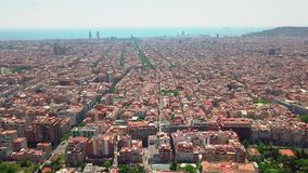Flying over Barcelona at sunset, Spain. Streets and houses in warm light of evening sun stock video footage