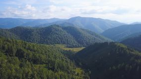 Flying over the beautiful mountain River and beautiful forest. Clip. Aerial camera shot. Landscape panorama. Altai royalty free stock photos