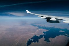 Airplane flying over the Nil River in Africa royalty free stock photography