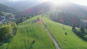 Flight over the forest in the mountains and village . Aerial view of Ukrainian Carpathians. Flying over the beautiful Ukrainian Carpathians mountain and stock video footage