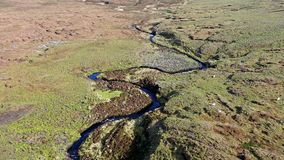 Flying over the River Rha between Staffin and Uig on the Isle of Skye , Scotland. Flying over the beautiful winding River Rha between Staffin and Uig on the Isle stock video