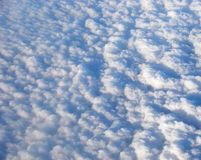 Flying over Bed of Clouds Royalty Free Stock Photo