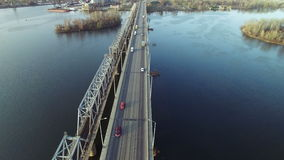 Flying over the bridge across the river stock video footage