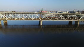 Flying over the bridge across the river stock footage
