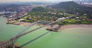 Aerial drone view of Bridge of the Americas in Panama City. Flying over Bridge of the Americas with Panama Canal in background stock footage