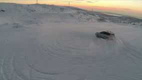 Flying over the car drifting on snow stock video