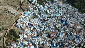 Flying over Chefchaouen and a blue city in Morocco with Drone from above (Aerial) stock video