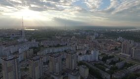 Flying over the city during a beautiful sunset. stock footage