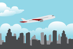 Flying Over The City. Domestic Plane Flying Over The City on Sunny Day Stock Photo