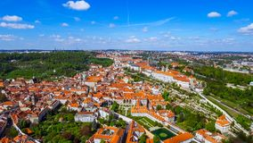 Flying Over The City Of Prague feat. Historic Old Gothic Buildings In Czechia. Flying Over Aerial View The City Of Prague feat. Historic Old Gothic Buildings In Stock Photography