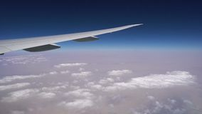 Flying over the clouds on a passenger airliner. beautiful big white plane flying high above the ground.  stock video