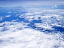 Flying over clouds in plane. Royalty Free Stock Image