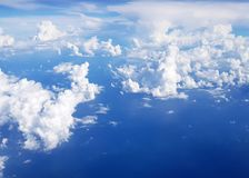 Flying over clouds in plane. Royalty Free Stock Images