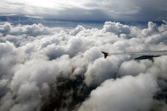 Flying over clouds in a plane,  wing of the Airbus Royalty Free Stock Photography