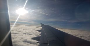 Flying over the clouds from San Francisco to China stock photography