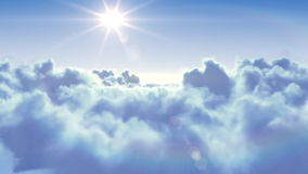 Flying over the clouds with the sun. stock video footage