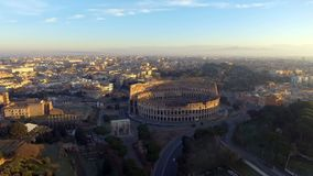 Flying over Colosseum, Rome, Italy. Aerial view of the Roman Coliseum on sunrise stock video footage