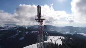 Flying over communications tower, mountain snow covered winter landscape. Beautiful winter nature aerial in the Carpathian Mountains, inspiration landscape stock footage