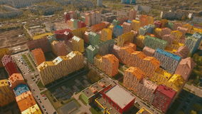Flying over cozy comfortable colorful buildings in a European city 4K UHD aerial stock video footage