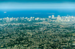 Flying Over Dar Es Salaam. Aerial view of the skyline of the city of Dar Es Salaam, Tanzania, with the Indian Ocean on the horizon Royalty Free Stock Photo