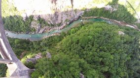 Flying over the Dzhurdzhevich`s bridge across the canyon of Tara river. Durmitor National Park. Montenegro stock video footage