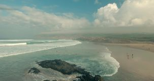 Flying Over Empty Sandy Beach and Ocean Waves. stock footage