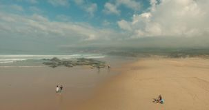 Flying Over Empty Sandy Beach and Ocean Waves. stock video footage