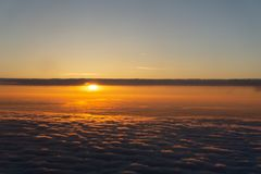 Flying over the evening timelapse clouds with the late sun. Flight through moving cloudscape with beautiful sun rays stock photography
