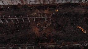 Excavator and old factory debris