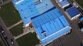 Flying over the factory with blue roof. aerial view of sewage treatment plant in wroclaw city. Aerial survey of the stock video footage
