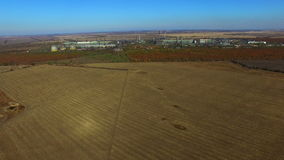 Flying over a field near the factory. Autumn. aerial survey stock video
