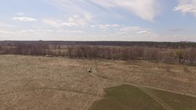 Flying over the field on which the vehicle travels. Aerial view. Video. Flying over the field on which the vehicle travels. Off road. Aerial view. Video 4k. Kiev stock footage