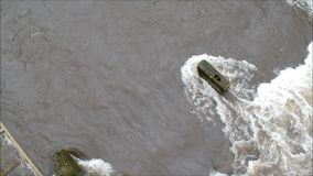 Flying over a flooded river in winter stock footage