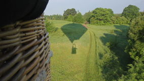 Flying over forest on hot air balloon stock video