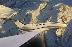 Flying over the glaciers. Low passage over the glaciers at sunrise royalty free stock photo