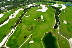 Flying over golf course Royalty Free Stock Photo
