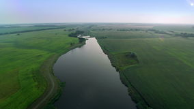 Flying Over Green Field and River. Aerial shot: Flying Over Green Field and River stock video