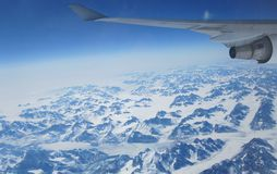 Flying over Greenland en route to Europe Royalty Free Stock Images