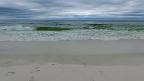 Flying Over the Gulf of Mexico and Beach in Pensacola, Florida. Cloudy evening sky stock video footage