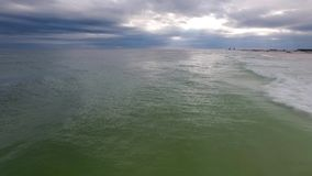 Flying Over the Gulf of Mexico and Beach in Pensacola, Florida. Cloudy evening sky.  stock footage