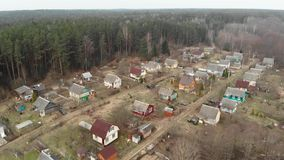 Flying over the holiday village. Early spring, dry grass stock video footage