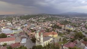 Flying over Holy Cross Greek Catholic Cathedral in Uzhhorod, Transcarpathia, Ukraine stock video