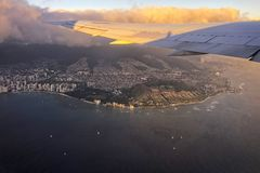 Flying over Honolulu, Hawaii with views of Diamond Head crater below stock photos