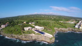 Flying over the house on the rock. Near the sea stock footage